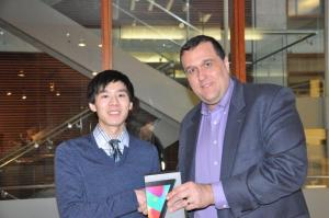 James Du receiving his Nexus 7 Wifi Tablet from Professor Werwath.